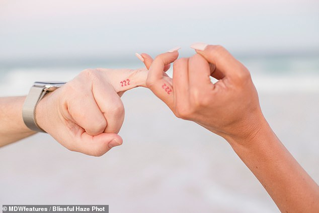 Bond: Seven months after they met, the couple cemented their bond by getting matching '222' tattoos on their fingers